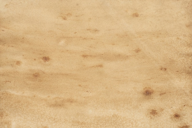 Старый фон гранж коричневой бумаги. абстрактная жидкая текстура цвета кофе.