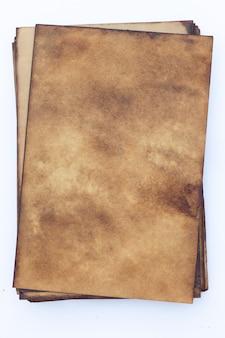 Старая поверхность гранж коричневой бумаги.