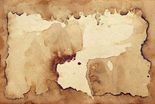 오래 된 갈색 종이 그런 지 벽. 추상 프레임 액체 커피 색상 질감입니다.