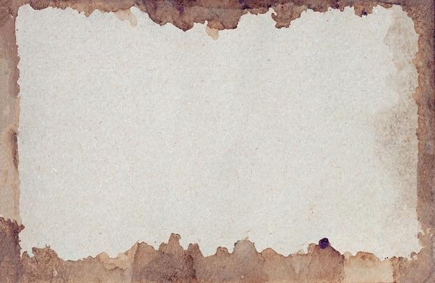 오래 된 갈색 종이 그런 지 벽. 액체 커피 색상 질감의 추상 프레임입니다.