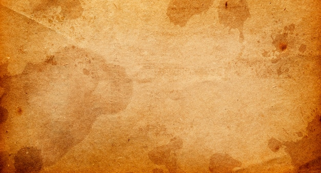 Старая коричневая бумага с пятнами и полосами для дизайна с местом для текста