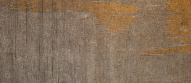 Old brown plywood sheet for background.