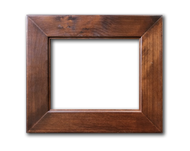 Old brown rustic wooden picture frame hanging on a white wall