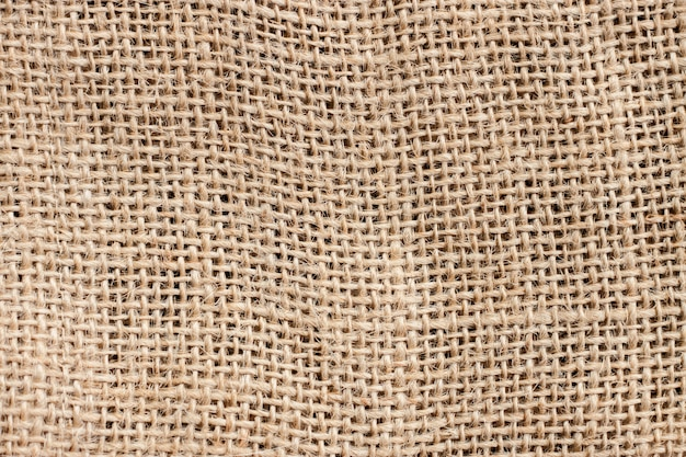 Old brown sackcloth texture and background, pattern abstract vintage fabric detail.