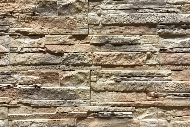 Old brown stone brick wall pattern background. interior decor and design texture