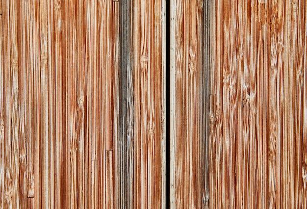 垂直木の板で作られた古い茶色のヴィンテージグランジ背景