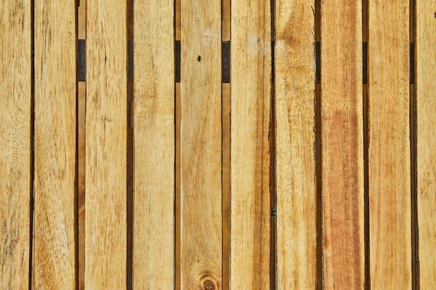 Старая коричневая винтажная поверхность гранж из вертикальных деревянных досок