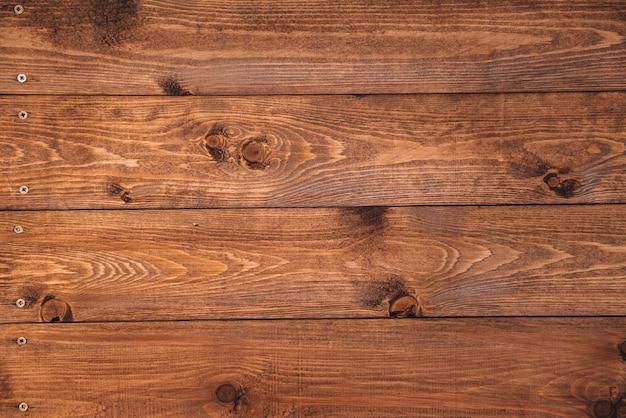 그루지 스타일의 짙은 천연 나무로 만든 오래된 갈색 나무 배경은 최상층의 자연 경관에서 볼 수 있습니다.