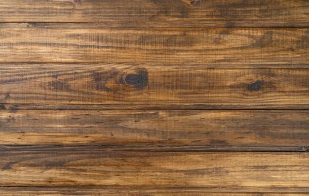 오래 된 갈색 나무 테이블입니다. 소박한 나무 배경입니다.