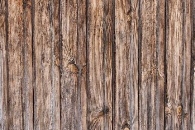 古い茶色の木のテクスチャの背景をクローズアップ