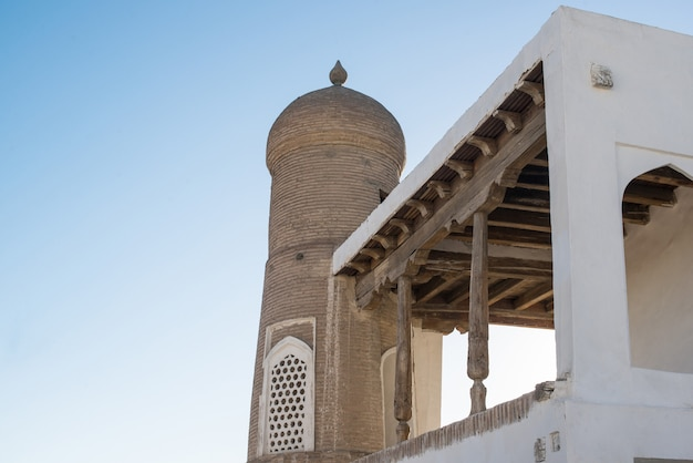 The old building with the arch and the dome. ancient buildings of medieval asia. bukhara, uzbekistan
