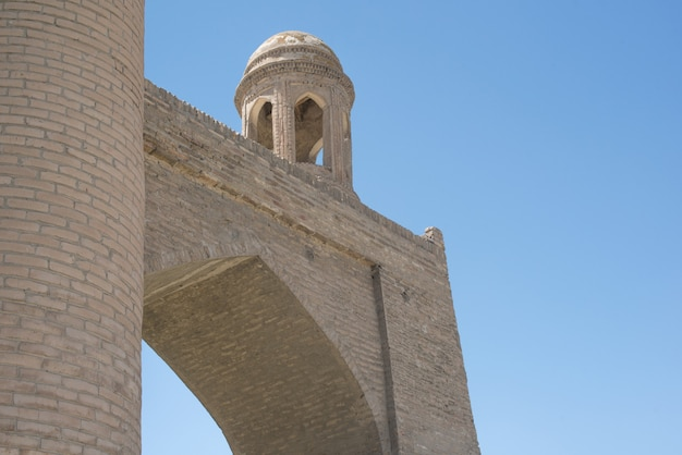 Old building with arch and dome. the ancient buildings of medieval asia. bukhara, uzbekistan