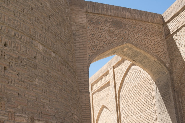 Old building with arch and passage. the ancient buildings of medieval asia. bukhara, uzbekistan