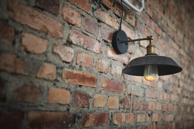 A old bulb on the old wall.