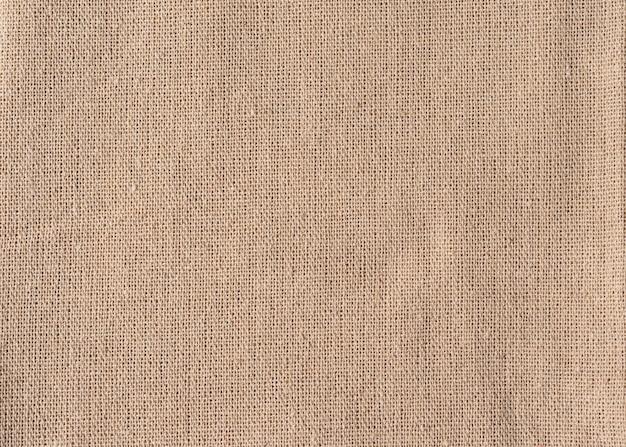古い黄麻布ナプキン、デザインのリネンの背景