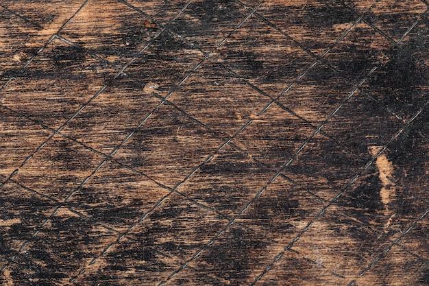 古い焦げた傷のある木の質感の背景