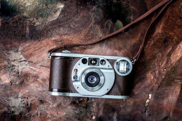 Old camera, film, vintage, retro, on wooden background