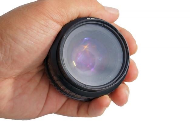 Старый объектив камеры в руке