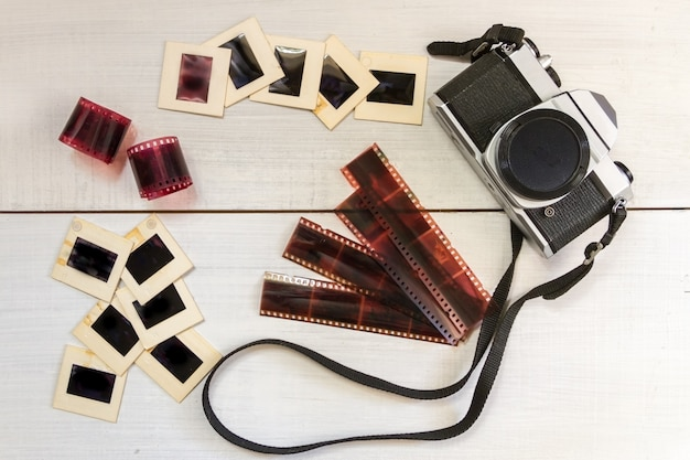 Old camera with negatives and slides photography
