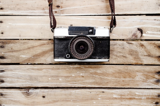 Old camera and on wooden table