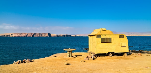 Old camper at the pacific ocean in paracas national reserve in peru