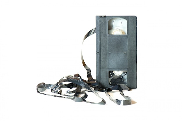An old cassette with the tape coming out.