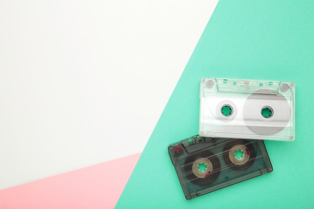 Old cassettes on a colorful background. music day