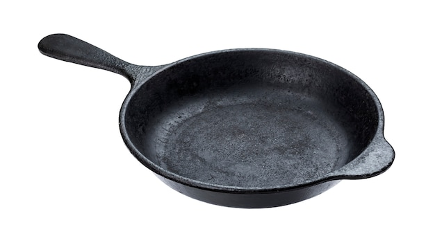 Old cast iron pan isolated on white with clipping path