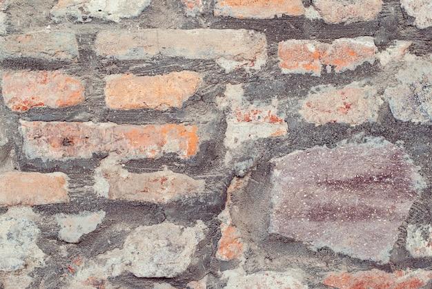 古い城の石の壁のテクスチャの背景