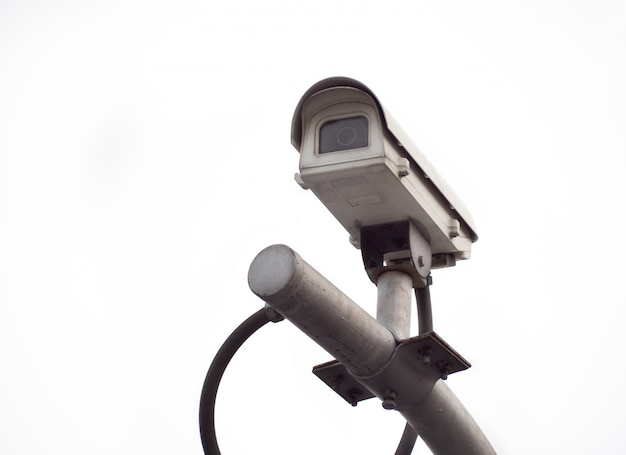 Old cctv security camera on a high pole