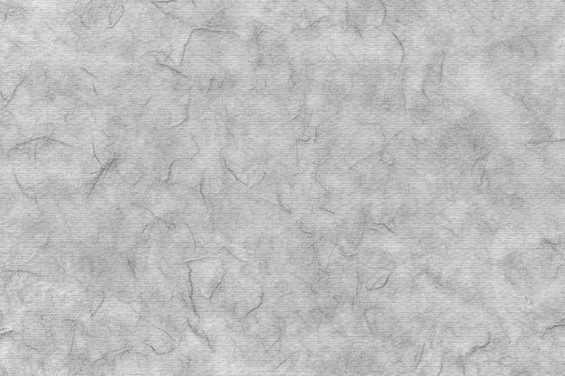 Vecchio muro di cemento con le crepe