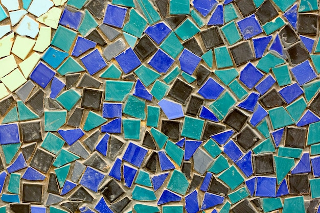 Old ceramic mosaic wall as a background.