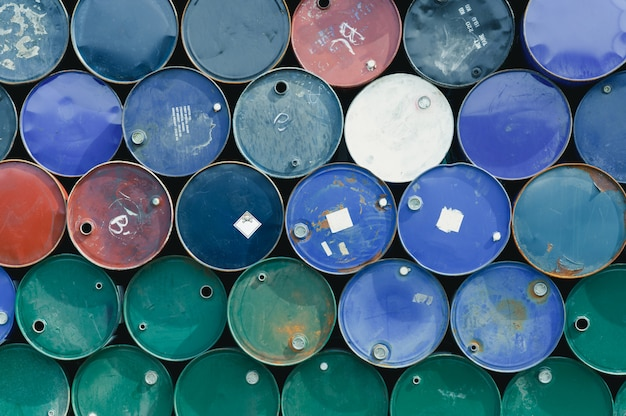 Old chemical barrels. blue, green, and red oil drum. steel oil tank. toxic waste warehouse.