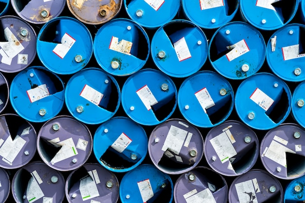 Old chemical barrels. blue and purple oil drum. steel oil tank. toxic waste warehouse.