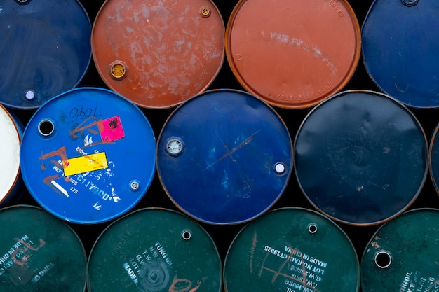 Old chemical barrels. oil drum. steel oil tank. toxic waste warehouse. hazard chemical barrel with warning label.