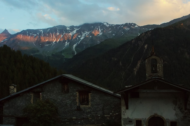 Old church surrounded by mountains and trees