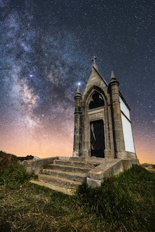 Old church with the milky way in the sky