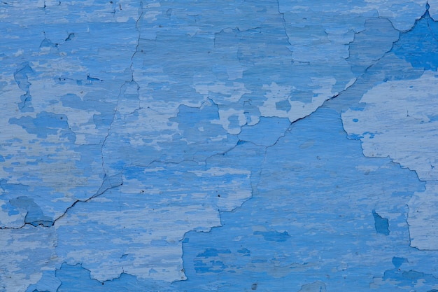 Old clay blue peeling wall background or texture
