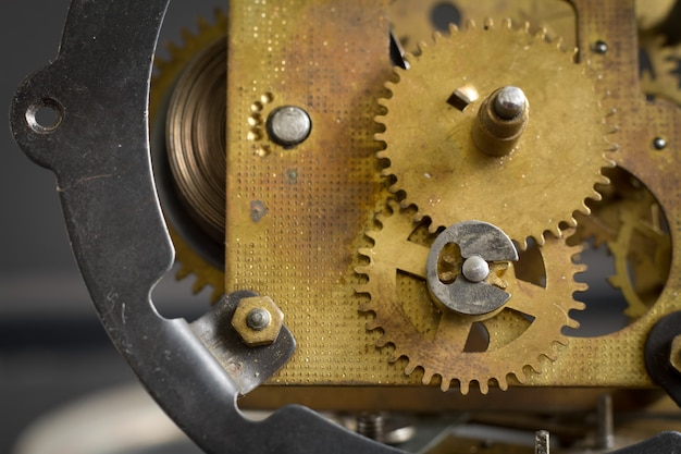 Old clock mechanism with gears and cogs.
