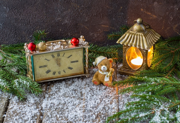 Old clock, an old lantern with a candle and a toy bear