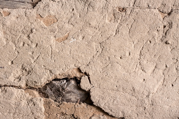 Old cob wall with cracked surface