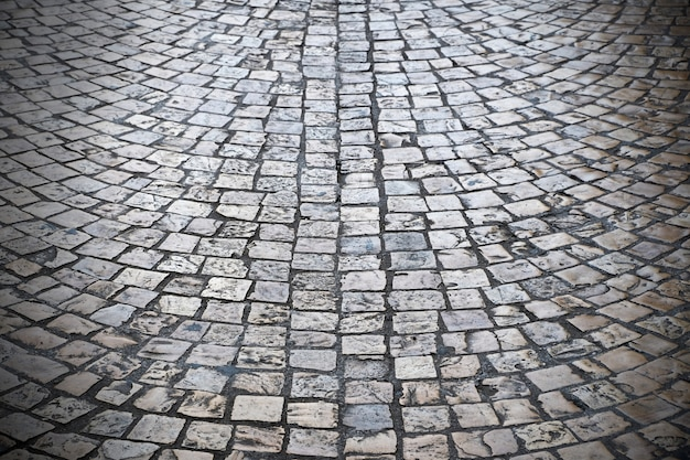 Old cobblestone street background texture dark vignette