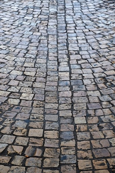 Old cobblestone street background texture vertical