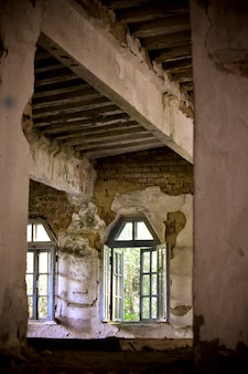 Old collapsing house open window