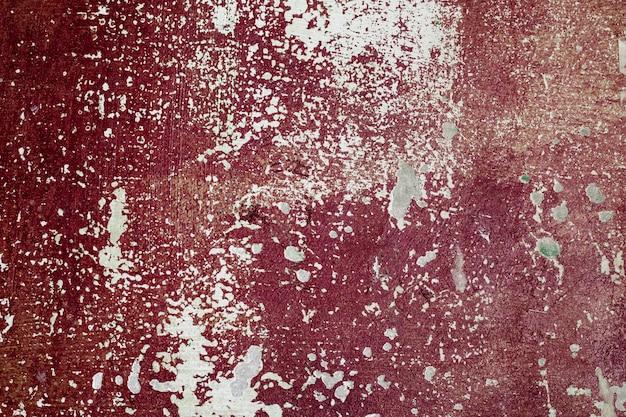 Старая покрашенная бетонная стена с краской шелушения. текстура