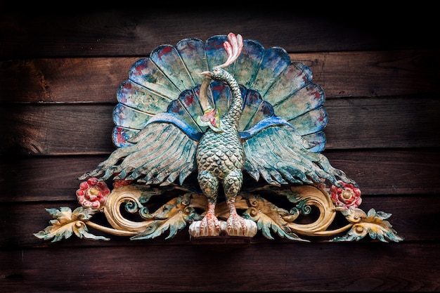 Old colorful  carving of peacock