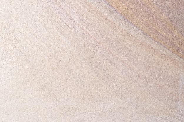 오래 된 다채로운 모래 돌 벽 질감 배경입니다. 바닥
