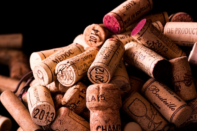 Old cork stoppers of french wines in a wire basket