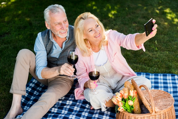 Old couple taking a selfie high angle