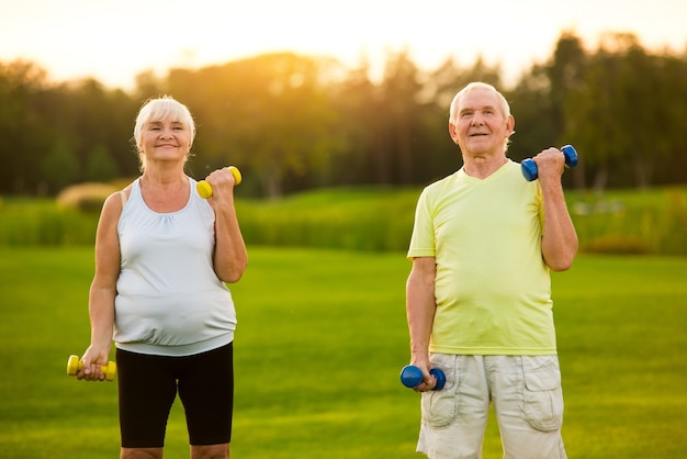 Old couple with dumbbells